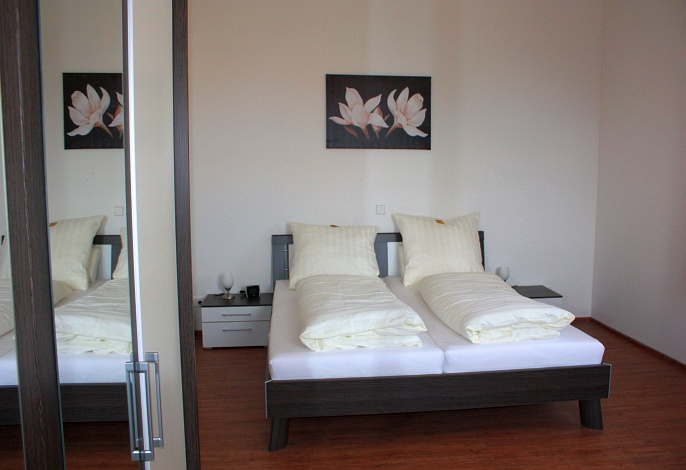 Ferienwohnung EG Deluxe: Schlafzimmer 1